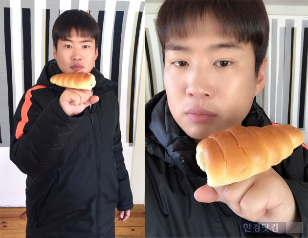 소라빵을 들고 포즈를 취하는 안재홍