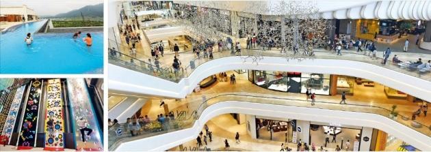 신세계그룹이 지은 국내 최대 복합쇼핑몰 스타필드하남(오른쪽)이 5일 부분 개장했다. 9일 정식으로 문을 여는 이곳에는 워터파크 아쿠아필드(왼쪽 위)와 스포테인먼트시설 스포츠몬스터(왼쪽 아래) 등이 들어선다. 허문찬 기자 sweat@hankyung.com