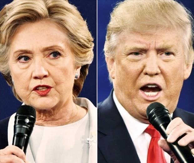 힐러리 클린턴 미국 민주당 대통령 후보(왼쪽)와 도널드 트럼프 공화당 후보가 9일(현지시간) 미국 미주리주 세인트루이스 워싱턴대에서 열린 2차 TV토론회에서 발언하고 있다. 두 후보는 트럼프의 음담패설 녹취파일 공개와 탈세 의혹, 클린턴의 이메일 스캔들 등 서로의 약점을 물고 늘어지며 난타전을 벌였다. 세인트루이스AFP연합뉴스