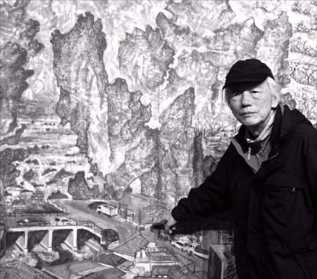 서양화가 민정기 씨가 금호미술관에 걸린 자신의 작품 '遊 몽유도원도'에 대해 설명하고 있다.