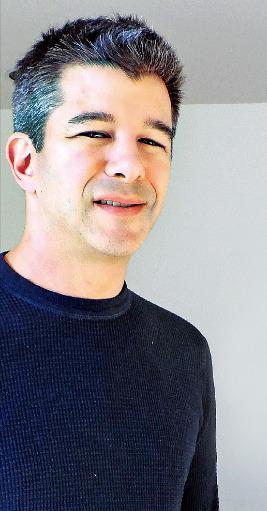 미국 샌프란시스코 우버 본사 집무실에서 트레비스 칼라닉 CEO가 포즈를 취하고 있다.
