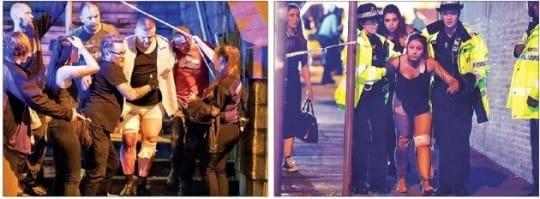 영국 맨체스터의 대형 실내 체육관 '맨체스터 아레나'에서 22일(현지시간) 일어난 폭발 사고로 다친 사람들이 부축을 받으며 현장을 빠져나오고 있다. 가디언홈페이지 캡처