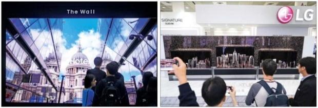 삼성전자와 LG전자가 TV 시장 주도권을 잡기 위해 차세대 디스플레이를 선보였다. 8일 서울 삼성동 코엑스에서 열린 국내 최대 정보기술(IT)·전자 전시회인 '한국전자전(KES) 2019'에서 삼성전자는 모듈형 디스플레이 '더월' 219인치(왼쪽)를, LG전자는 롤러블 OLED(유기발광다이오드) TV인 'LG 시그니처 올레드 R'을 전시했다.  /강은구  기자  egkang@hankyung.com·연합뉴스