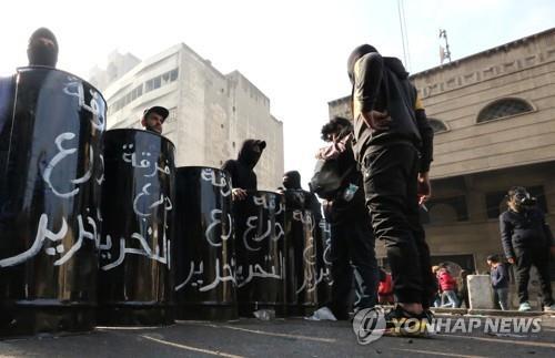 이라크, 대규모 반미집회 뒤 반정부 시위대 강경 진압