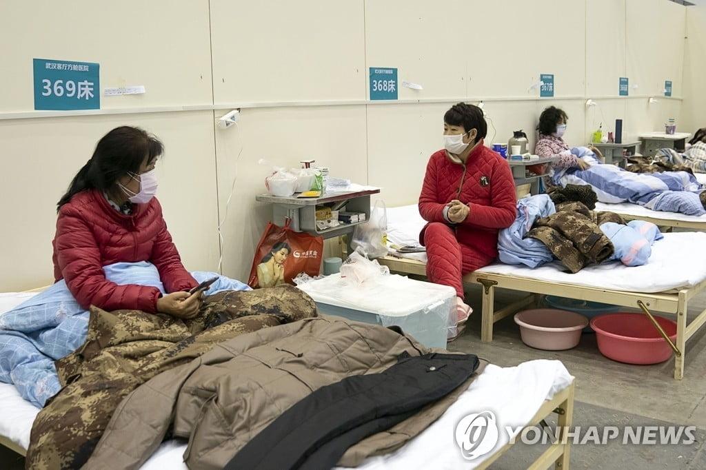 中 `신종코로나` 확산세 주춤…신규 확진자 8일째↓
