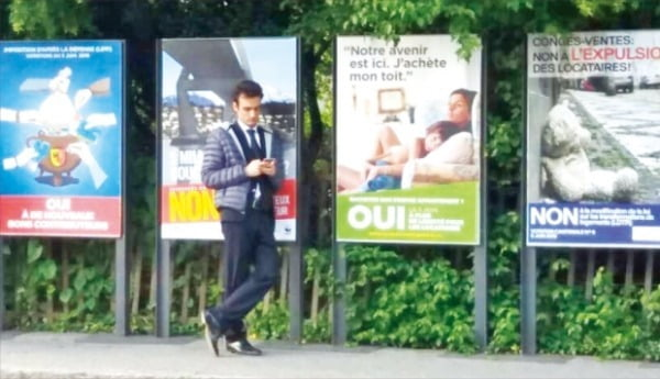 스위스가 기본소득 도입안에 대해 국민트표에 부쳤던 2016년 당시 버스정류장에 붙은 국민투표 포스터. 스위스는 국민 77%의 반대로 기본소득 도입안을 부결시켰다. 연합뉴스