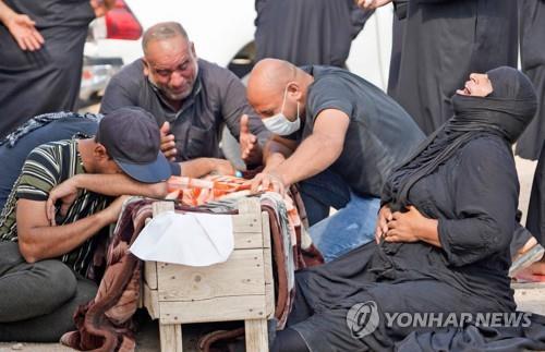 """""""이라크서 임시 매장된 '코로나19 시신' 유족에 인계"""""""