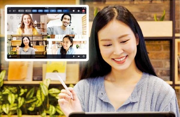 SK텔레콤이 지난 8월 선보인 영상회의 솔루션 '미더스'를 사용하는 모습.  SK텔레콤  제공