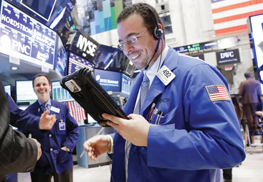 A Trader works on the floor of the NYSE after the closing bell on Wall Street In New York City on May 7, 2013. The Dow Jones Industrial Average closed above 15,000 for the first time in history.   UPI/John Angelillo/2013-05-08 06:00:39/