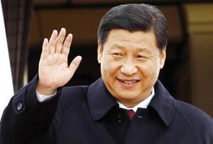 China's Vice President Xi Jinping waves upon arrival at Haneda International Airport  in Tokyo, Japan, Monday, Dec. 14, 2009. (AP Photo/Shizuo Kambayashi)
