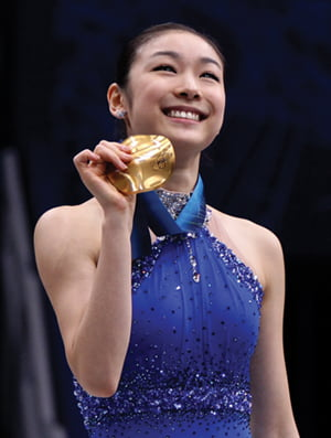 South Korea's Kim Yu-Na poses on the podium after winning the gold medal in the women's figure skating competition at the Vancouver 2010 Olympics in Vancouver, British Columbia, Thursday, Feb. 25, 2010. (AP Photo/Mark Baker)/2010-02-26 14:28:01/