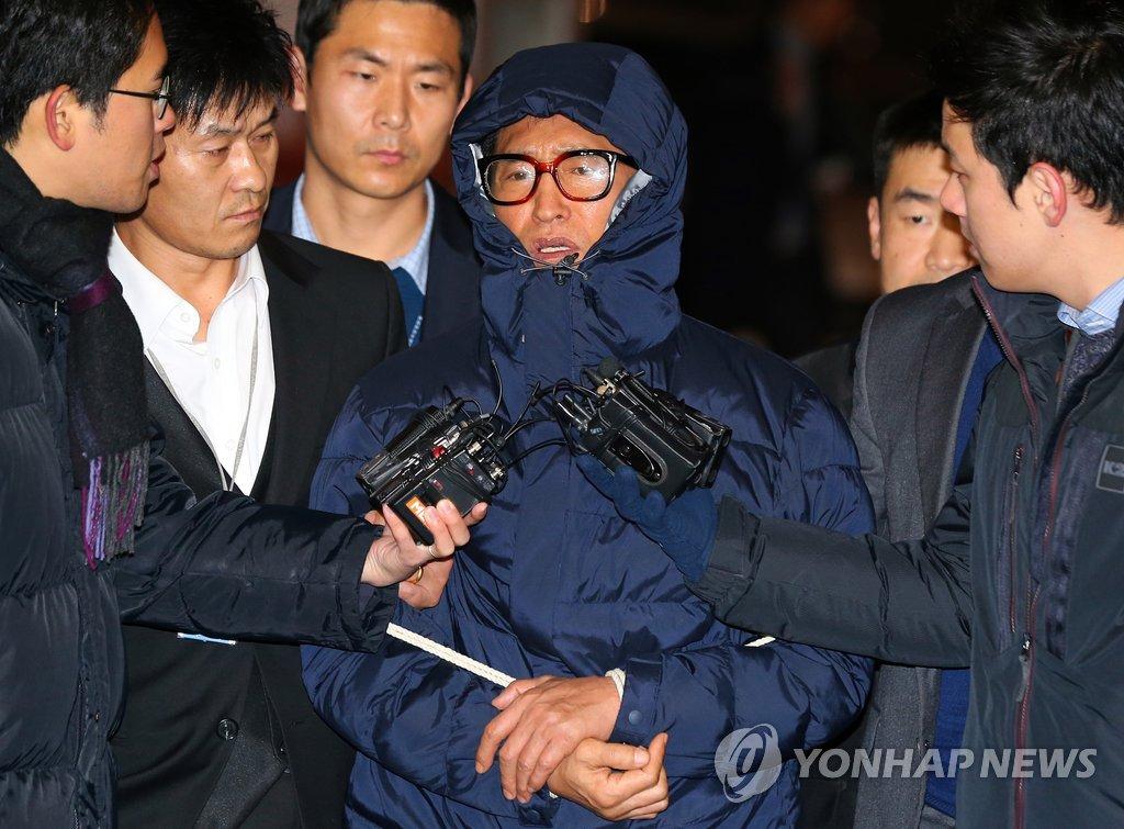 '채무자 폭행' 조양은 공범 8년만에 검거…구속 송치
