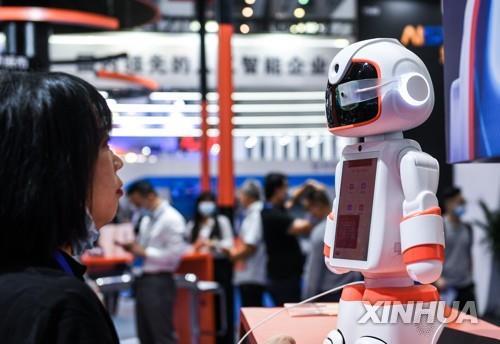 """中 희토류·로봇 등 8대산업 육성 예고…""""10년 칼 하나 갈듯"""""""
