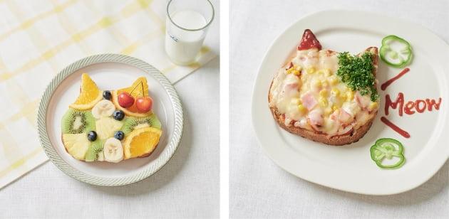 과일과 피자치즈로 장식 된 고양이 식빵