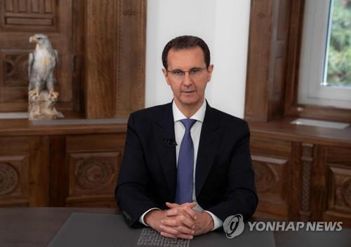"""4선 성공한 독재자 알아사드…""""모든 적 물리칠 것"""""""