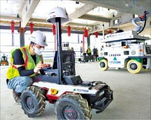 페인트·용접…'무인로봇'이 아파트 짓는다